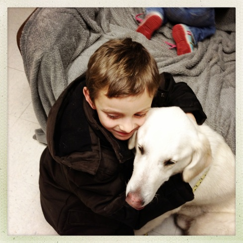 Collin loving on a dog we really wanted to take home from the shelter, but we adopted a different one later...